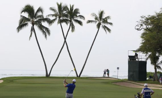 Jan 15, 2016; Honolulu, HI, USA; PGA golfer Brandt Snedeker hits his approach shot on the 16th hole during the second round of the Sony Open in Hawaii golf tournament at Waialae Country Club. Mandatory Credit: Brian Spurlock-USA TODAY Sports